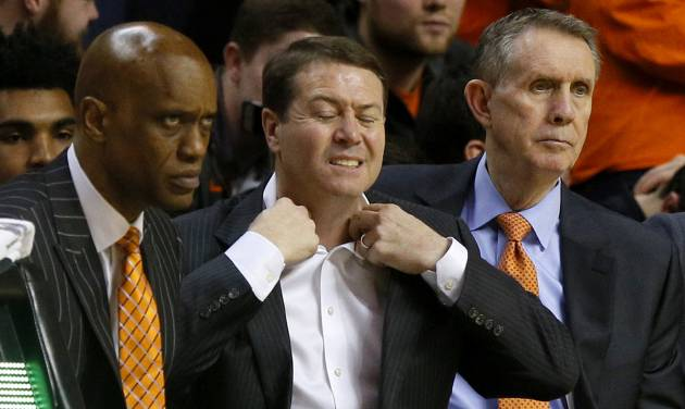 Oklahoma State coach Travis Ford loosens his collar during a college basketball game between the Cowboys and Iowa State Cyclones on Saturday in at Gallagher-Iba Arena. The Cowboys, who play TCU on Monday night, are struggling with injuries. (Photo by Bryan Terry, The Oklahoman)