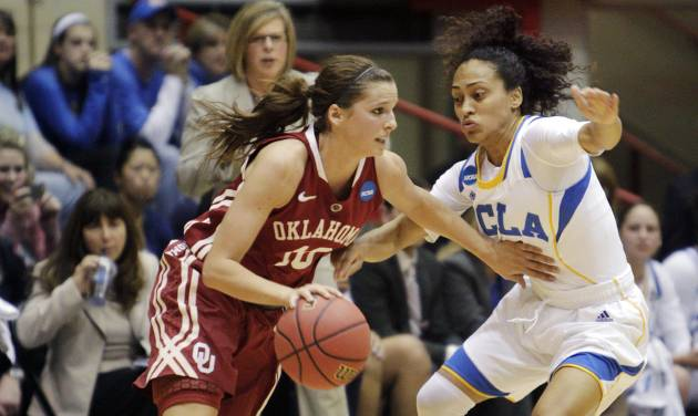 Oklahoma's Morgan Hook, left, dribbles upcourt as UCLA's Mariah Williams defends during the first half of a second-round game in the women's NCAA college basketball tournament, Monday, March 25, 2013, in Columbus, Ohio. (AP Photo/Jay LaPrete) ORG XMIT: OHJL104