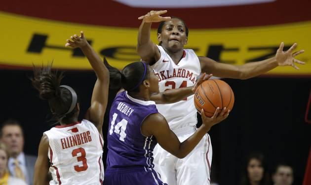 OU: Oklahoma's Sharane Campbell (24) and Aaryn Ellenberg (3) defend TCU's Zahna Medley (14) during a women's college basketball game between the University of Oklahoma and TCU at the Lloyd Noble Center in Norman, Okla., Wednesday, Jan. 30, 2013. Oklahoma won 74-53. Photo by Bryan Terry, The Oklahoman