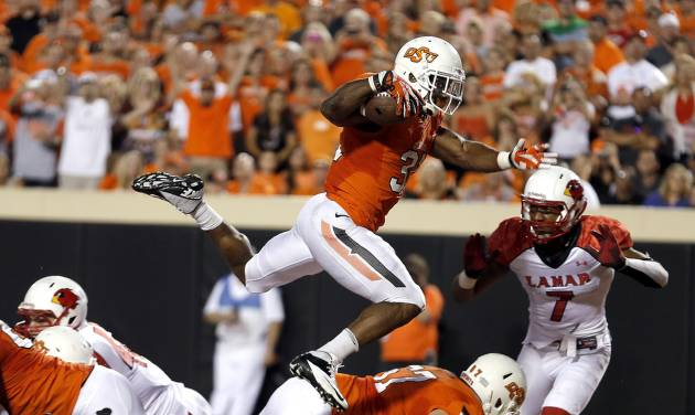 Oklahoma State's Jeremy Smith (31) leaps into the end zone for a touchdown during a college football game between the Oklahoma State University Cowboys (OSU) and the Lamar University Cardinals at Boone Pickens Stadium in Stillwater, Okla., Saturday, Sept. 14, 2013. Photo by Sarah Phipps, The Oklahoman