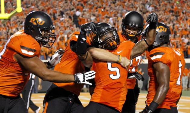 CELEBRATION: Oklahoma State's Josh Stewart (5) celebrates after catching a touchdown pass during a college football game between Oklahoma State University (OSU) and the University of Texas (UT) at Boone Pickens Stadium in Stillwater, Okla., Saturday, Sept. 29, 2012. Photo by Bryan Terry, The Oklahoman