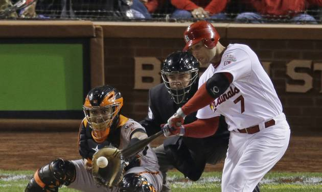 St. Louis Cardinals' Matt Holliday hits an RBI single during the first inning of Game 4 of baseball's National League championship series against the San Francisco Giants Thursday, Oct. 18, 2012, in St. Louis. (AP Photo/Mark Humphrey)  ORG XMIT: NLCS130