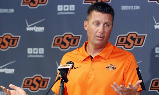 Oklahoma State head coach Mike Gundy answers a question during an NCAA college football news conference in Stillwater, Okla., Monday, Sept. 24, 2012. Gundy believes injured starting quarterback Wes Lunt could return to practice by the end of this week, although he's still uncertain whether he'll be able to play in Saturday night's game against Texas. (AP Photo/Sue Ogrocki)