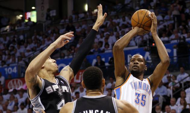 Oklahoma City's Kevin Durant (35) shoots over San Antonio's Danny Green (4) and Tim Duncan (21) during Game 6 of the Western Conference Finals in the NBA playoffs between the Oklahoma City Thunder and the San Antonio Spurs at Chesapeake Energy Arena in Oklahoma City, Saturday, May 31, 2014. Photo by Bryan Terry, The Oklahoman