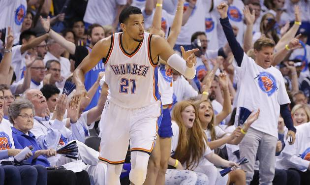 Oklahoma City\'s Andre Roberson (21) celebrates after a basket during Game 4 of the Western...