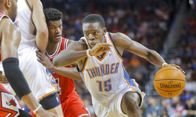 Oklahoma City Thunder's Reggie Jackson, right, turns the corner on Chicago Bulls' Jimmy Butler in the second quarter during their preseason NBA basketball game in Wichita, Kan., Wednesday, Oct. 23, 2013. (AP Photo/The Wichita Eagle, Fernando Salazar) LOCAL TV OUT; MAGAZINES OUT; LOCAL RADIO OUT; LOCAL INTERNET OUT