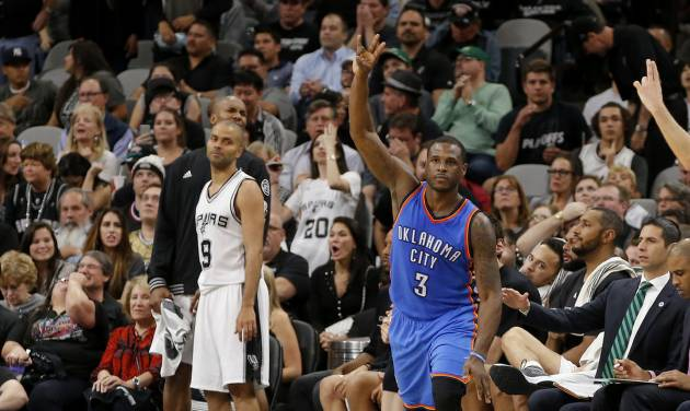 Oklahoma City's Dion Waiters (3) celebrates a 3-pointer beside San Antonio's Tony Parker (9) during Game 2 of the second-round series between the Oklahoma City Thunder and the San Antonio Spurs in the NBA playoffs at the AT&T Center in San Antonio, Monday, May 2, 2016. Oklahoma City won 98-97. Photo by Bryan Terry, The Oklahoman