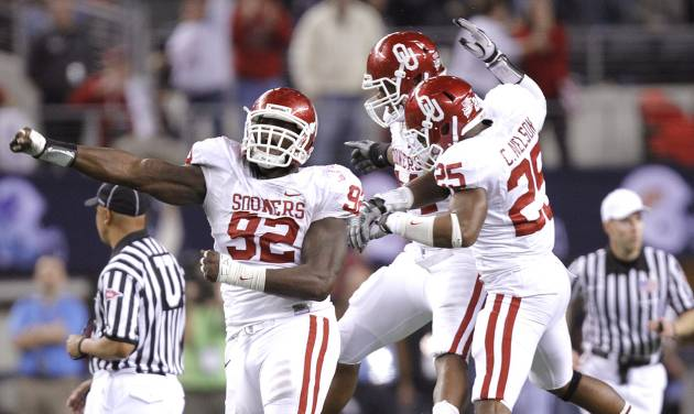 COLLEGE FOOTBALL / BIG 12 CHAMPIONSHIP: The Sooners' Stacy McGee (92) Jeremy Beal (44) and Corey Nelson (25) after stopping Nebraska on fourth down late in the fourth quarter to seal the 23-20 win in the Big 12 football championship game between the University of Oklahoma Sooners (OU) and the University of Nebraska Cornhuskers (NU) at Cowboys Stadium on Saturday, Dec. 4, 2010, in Arlington, Texas.  Photo by Chris Landsberger, The Oklahoman ORG XMIT: KOD