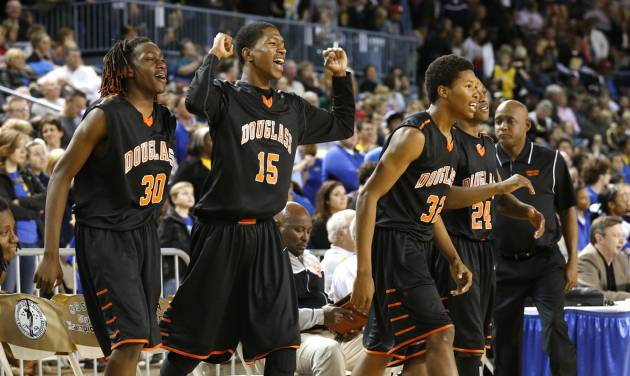 Antonio Fortune (30), Paterick McKaufman (15) and Aaron McKinney (32) react as the Douglass Trojans win 79-70 during the 4A boys semifinal game between the Douglass High School Trojans and Victory Christian's Conquorers at the State Fair Arena on Friday, March 8, 2013 in Oklahoma City, Okla.  Photo by Steve Sisney, The Oklahoman