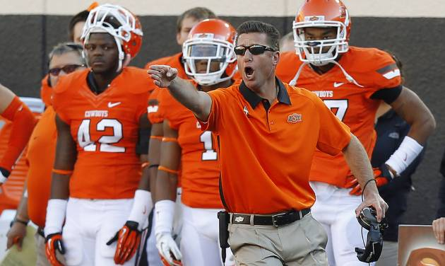 REACTION: OSU coach Mike Gundy reacts during a college football game between Oklahoma State University (OSU) and Texas Tech University (TTU) at Boone Pickens Stadium in Stillwater, Okla., Saturday, Nov. 17, 2012.  Photo by Bryan Terry, The Oklahoman
