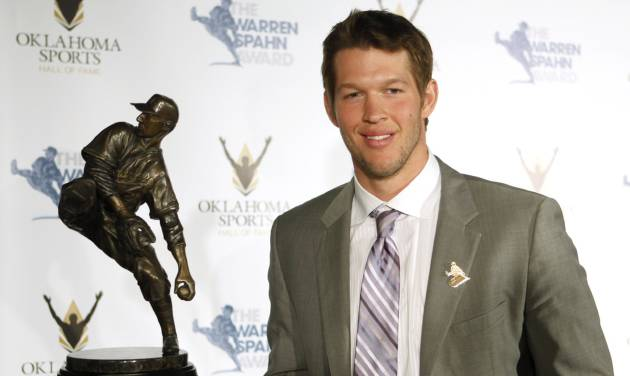 L. A. Dodgers pitcher Clayton Kershaw poses for a photo with the Warren Spahn Award, given to the best left-handed pitcher in Major League Baseball on at the Oklahoma Sports Hall of Fame on Tuesday, Jan. 28, 2014, in Oklahoma City. Photo by KT King, The Oklahoman