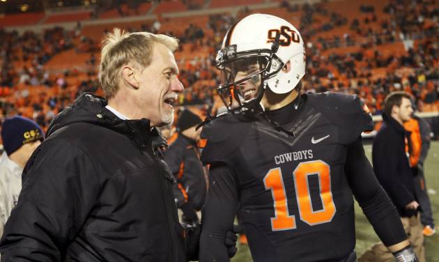 OSU defensive coordinator Glenn Spencer, left, talks to quarterback Clint Chelf after the Cowboys' 49-17 win over Baylor last Saturday. Photos by Nate Billings, The Oklahoman