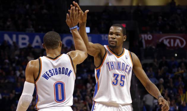 Oklahoma City's Russell Westbrook (0) and  Oklahoma City's Kevin Durant (35) celebrate during the NBA game between the Oklahoma City Thunder and the Indiana Pacers at the Chesapeake Energy Arena, Sunday, Dec. 8, 2013. Photo by Sarah Phipps, The Oklahoman