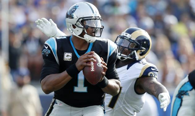 Cam Newton gets roughed up a bit, but Panthers survive against Rams