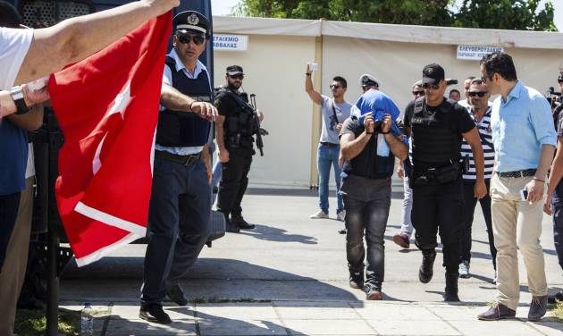 Greek court agrees to extradite members of Turkish military