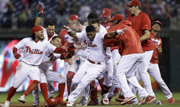 Hellickson's 3-hitter leads Phillies over Marlins 8-0