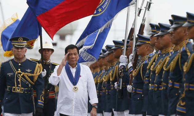 philippine president rodrigo duterte salutes as he reviews the troops