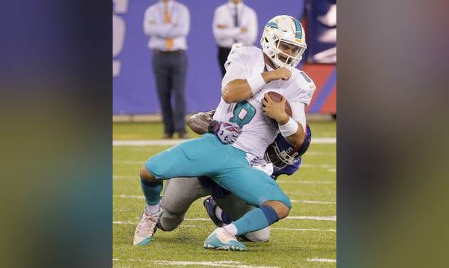 Nassib stumbles in start for Manning, Dolphins win 27-10