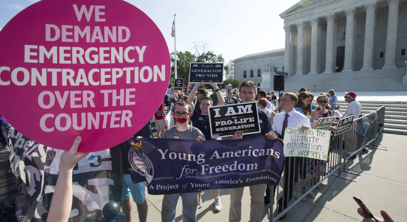 Activists demonstrate in front of the Supreme Court in Washington, Monday, June 27, 2016, as the...