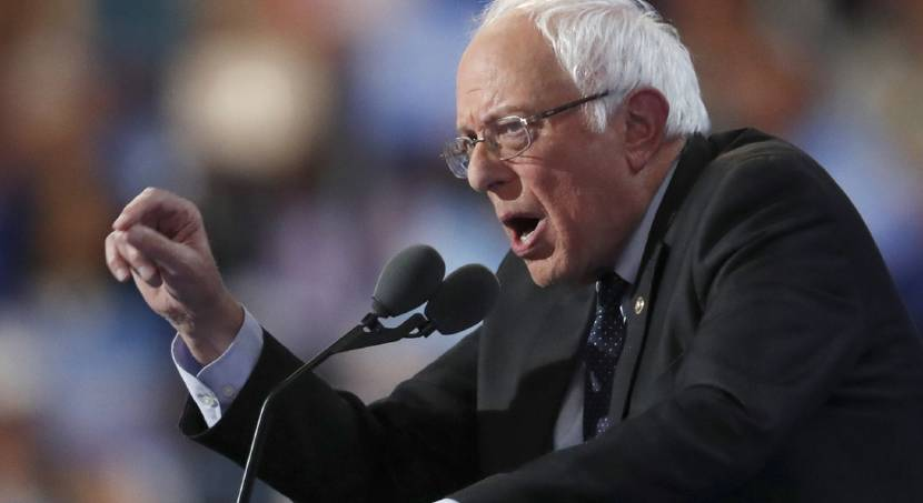 Sanders tries to spur supporters to switch  to Clinton