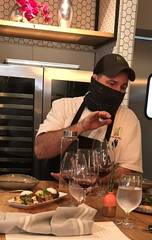 Chef Josh Valentine, masked up, at Livegrass Butcher + Bistro. [Dave Cathey/The Oklahoman]