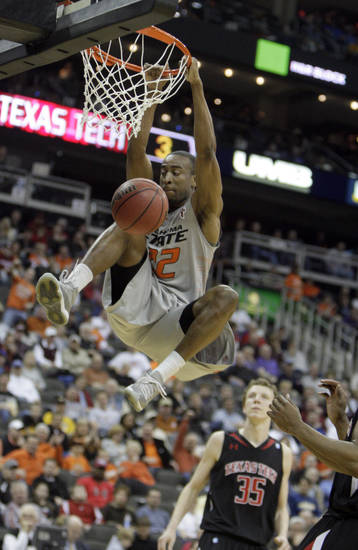 Oklahoma State's Markel Brown (22) dunks the ball during the Big 12 tournament men's basketball game between the Oklahoma State Cowboys and the Texas Tech Red Raiders at the Sprint Center, Wednesday, March, 6, 2012. Photo by Sarah Phipps, The Oklahoman