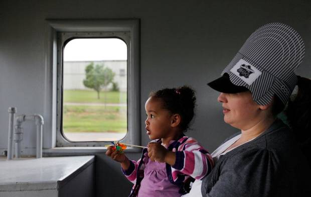 Margaret Robinson holds her daughter, Marion Robinson, 2, as they take a train ride at the Oklahoma Railway Museum, 3400 NE Grand Blvd., in Oklahoma City, Saturday, April 7, 2012. The museum gives train rides the 1st and 3rd Saturday from April through August. Photo by Nate Billings, The Oklahoman