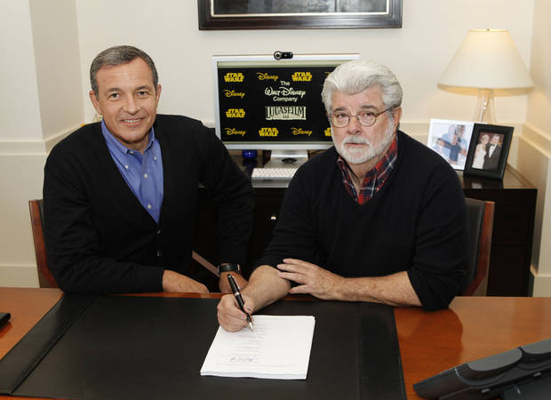 Disney President and CEO Robert Iger, left, and filmmaker George Lucas, of LucasFilm Ltd., are shown Tuesday in Burbank, Calif. The Walt Disney Co. announced Tuesday that it was buying Lucasfilm Ltd. for $4.05 billion. AP Photo