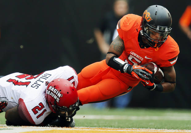 ULL's Rodney Gillis (21) stops OSU's Josh Stewart (5) during a college football game between Oklahoma State University and the University of Louisiana-Lafayette at Boone Pickens Stadium in Stillwater, Okla., Saturday, Sept. 15, 2012. Photo by Nate Billings, The Oklahoman