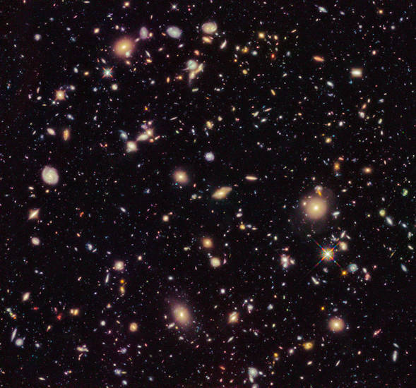 In this image provided by NASA and taken by the Hubble Space Telescope shows previously unseen early galaxies including the oldest one at 13.3 billion years old. Launched in 1990, Hubble has peered deep in time to reveal distant and old galaxies. <strong> - AP photo</strong>