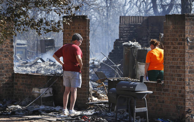 Residents  in Luther were allowed to return to the their homes early Saturday, Aug. 4, 2012, after they fled a rapidly moving wildfire yesterday that consumed at least seven structures on South Dogwood Street, leaving smoldering ashes where family homes once stood.  