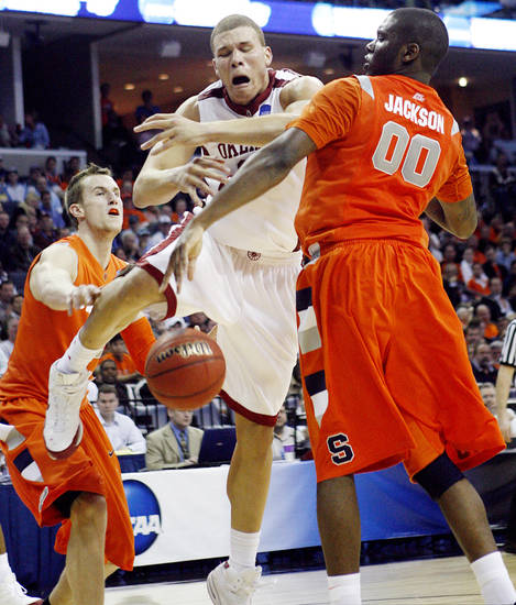 Oklahoma's Blake Griffin (23) is fouled by Syracuse's Rick Jackson (00) during the second half of the NCAA Men's Basketball Regional at the FedEx Forum on Friday, March 27, 2009, in Memphis, Tenn.