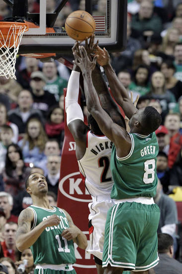Boston Celtics forward Jeff Green, right, comes in from behind to block a shot by Portland Trail Blazers center J.J. Hickson as Celtic guard Courtney Lee watches at left during the first quarter of an NBA basketball game in Portland, Ore., Sunday, Feb. 24, 2013. (AP Photo/Don Ryan)