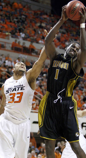 Missouri's DeMarre Carroll grabs a rebound over OSU's Marshall Moses during the Big 12 college basketball game between Oklahoma State and Missouri at Gallagher-Iba Arena in Stillwater, Okla., Wednesday, Jan. 21, 2009.  PHOTO BY BRYAN TERRY, THE OKLAHOMAN