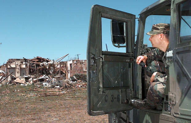Tornado damage: National Guard Delta 1-179 Infantry from Ponca City and Tonkawa on duty in Moore across from the First Baptist Church in the Highland Park housing Addition.  Staff Sgt. Tony Mylar of Ponca City at the guards command post set up on Cedar Lane.