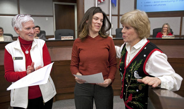 Kara Joy McKee (center) receives the city's annual Human Rights Award from Kay Ham (left) and Mayor Cindy Rosenthal on Tuesday, Dec. 13, 2011, in Norman, Okla.    Photo by Steve Sisney, The Oklahoman