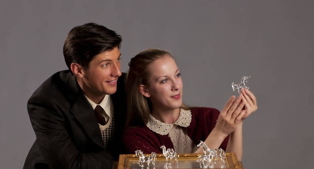 "Jim (Dallas Lish) admires Laura's (Lindsay Pittman) collection of glass figurines in this scene from ""The Glass Menagerie.""   Photo by Keith Rinearson <strong>Photo by Keith Rinearson</strong>"