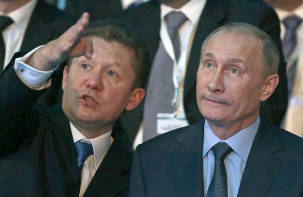 Russian President Vladimir Putin, right, and Gazprom CEO Alexei Miller speak during a Gazprom ceremony in Anapa, Russia, Friday, Dec. 7, 2012.  Russian energy giant Gazprom on Friday launched the construction of the South Stream pipeline which is expected to be delivering up to 63 billion cubic meters of Russian gas to Europe annually starting 2015. (AP Photo/Mikhail Metzel)
