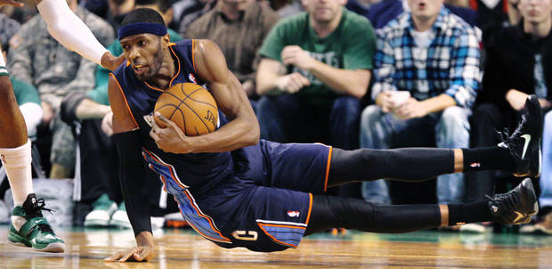Charlotte Bobcats forward Hakim Warrick grabs a loose ball as he hits the court against the Boston Celtics during the first quarter of an NBA basketball game in Boston, Monday, Jan. 14, 2013. (AP Photo/Charles Krupa)