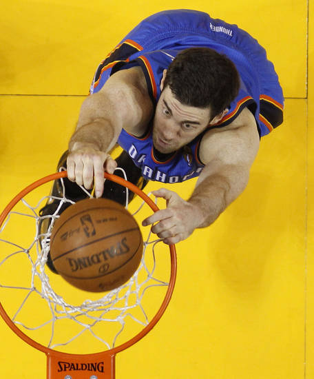 Oklahoma City Thunder power forward Nick Collison (4) dunks against the Miami Heat during the first half at Game 3 of the NBA Finals basketball series, Sunday, June 17, 2012, in Miami. (AP Photo/Mike Segar, Pool) ORG XMIT: NBA141