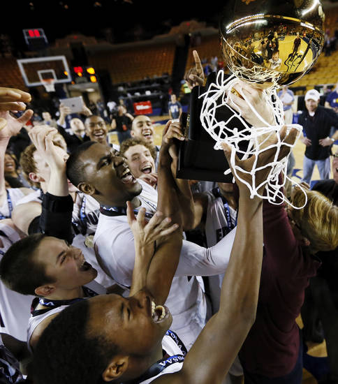 The Edmond Memorial Bulldogs raise the gold ball after winning the Class 6A boys championship high school basketball game against Midwest City in the state tournament at the Mabee Center in Tulsa, Okla., Saturday, March 9, 2013. Edmond Memorial won, 49-48. Photo by Nate Billings, The Oklahoman