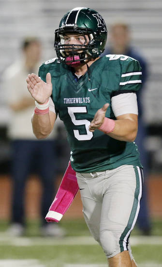 Norman North's Beau Proctor (5) claps after a play during a high school football game between Edmond North and Norman North in Norman, Okla., Thursday, Oct. 11, 2012. Photo by Nate Billings, The Oklahoman