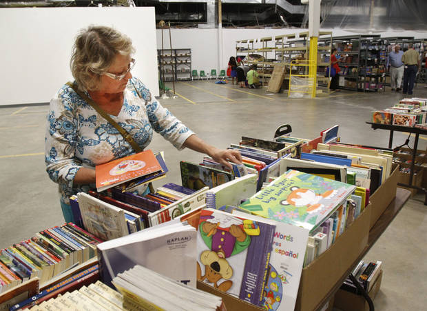 Billie Slavin, first-grade teacher at Arbor Grove Elementary School in the Putnam City School District, picks out school supplies at Feed the Children's new Teachers Store. Photo by Paul Hellstern, The Oklahoman <strong>PAUL HELLSTERN</strong>