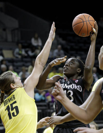 Stanford forward Chiney Ogwumike, right, shoots against Oregon forward Liz Brenner during the first half of an NCAA college basketball game in Eugene, Ore., Friday, Feb. 1, 2013. (AP Photo/Don Ryan)