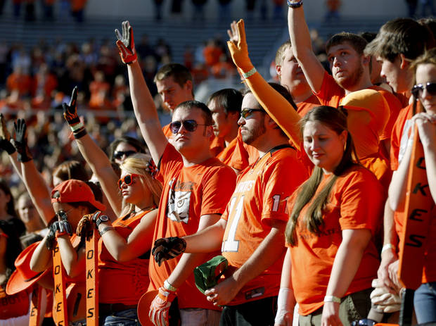 OSU fans pause for a moment of silence to remember the four people killed in a plane crash on a recruiting trip in November of 2011, before a college football game between Oklahoma State University (OSU) and Texas Tech University (TTU) at Boone Pickens Stadium in Stillwater, Okla., Saturday, Nov. 17, 2012.  Photo by Bryan Terry, The Oklahoman