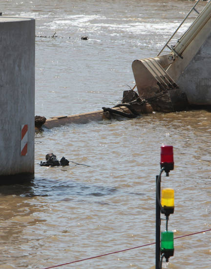 Oklahoma City Fire Department divers search for a victim of the May 31st storms in the Oklahoma River near May Avenue on Friday. Photo by David McDaniel, The Oklahoman <strong>David McDaniel - The Oklahoman</strong>