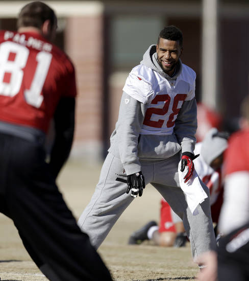 Atlanta Falcons' Thomas DeCoud stretches during NFL football practice at the team's training facility, Friday, Jan. 18, 2013, in Flowery Branch, Ga. The Falcons host the San Francisco 49ers in the NFC championship on Sunday. (AP Photo/David Goldman)