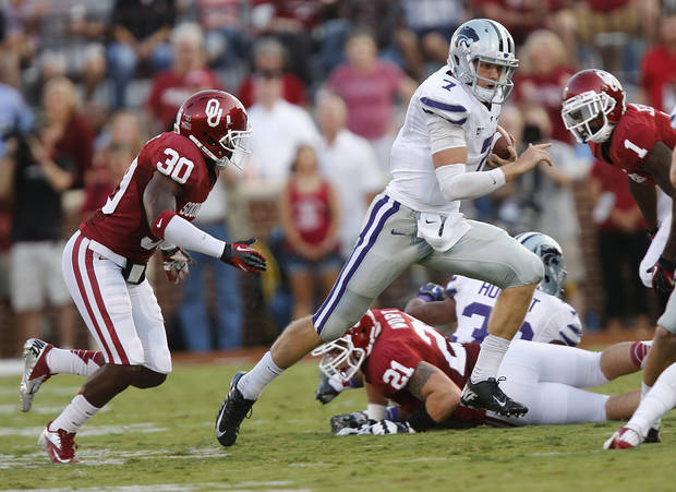 Kansas State's Collin Klein(7) runs past Oklahoma's Javon Harris (30) during the college football game between the University of Oklahoma Sooners (OU) and the Kansas State University Wildcats (KSU) at the Gaylord Family-Memorial Stadium on Saturday, Sept. 22, 2012, in Norman, Okla. Photo by Chris Landsberger, The Oklahoman