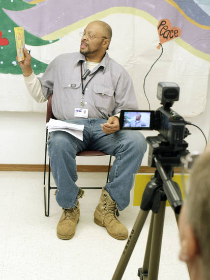 Gregory Fagan reads to his children by video, as the Oklahoma Message Project videotapes the Christmas messages of incarcerated men at Clara Waters CCC in Oklahoma City, OK, Tuesday, Dec. 13, 2011. By Paul Hellstern, The Oklahoman