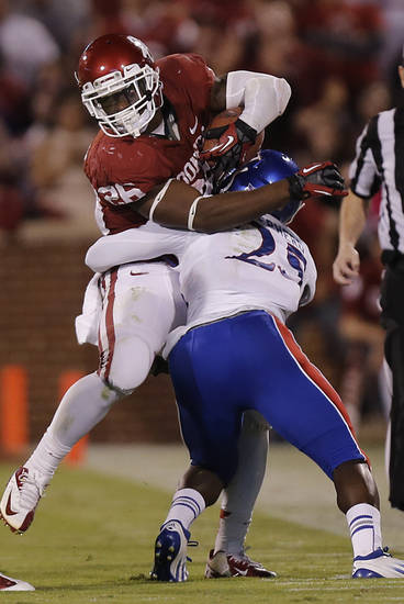 KU's JaCorey Shepherd (25) stops OU's Damien Williams (26) during the college football game between the University of Oklahoma Sooners (OU) and the University of Kansas Jayhawks (KU) at Gaylord Family-Oklahoma Memorial Stadium on Saturday, Oct. 20th, 2012, in Norman, Okla. Photo by Chris Landsberger, The Oklahoman